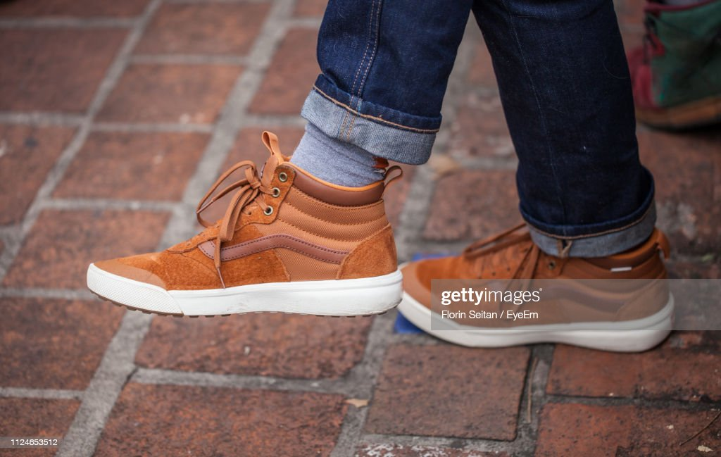 Low Section Of Man On Footpath : Stock Photo
