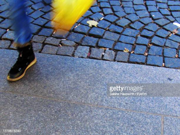 low section of man on street - sabine hauswirth stock pictures, royalty-free photos & images