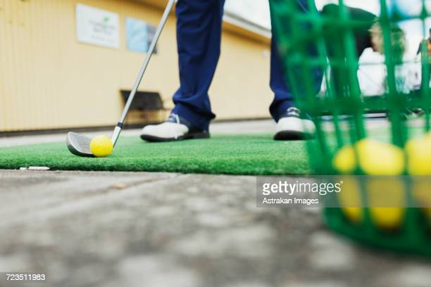 low section of man playing golf at driving range - driving range stock pictures, royalty-free photos & images