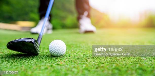 low section of man playing golf - golf club stock pictures, royalty-free photos & images