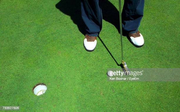 low section of man playing golf - putting stock pictures, royalty-free photos & images
