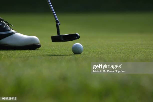 low section of man playing golf - green golf course stock pictures, royalty-free photos & images
