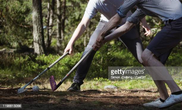 low section of man playing in forest - colbing stock pictures, royalty-free photos & images