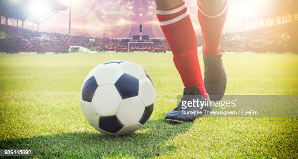 low section of man playing on soccer field - soccer ball stock pictures, royalty-free photos & images