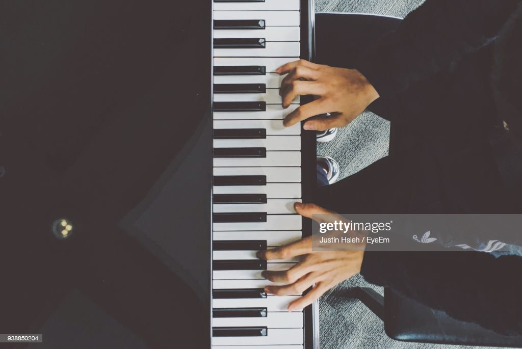 Low Section Of Man Playing Piano : Stock Photo