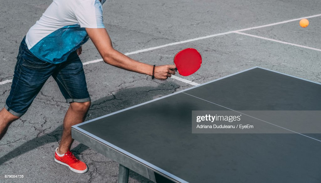 Low Section Of Man Playing Table Tennis : Stock Photo