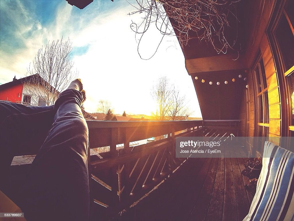 Low Section Of Man Relaxing In Balcony : Foto stock