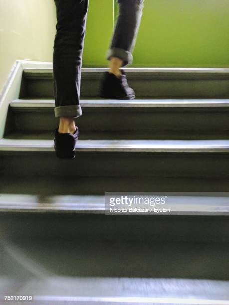 Low Section Of Man Rushing Up Steps