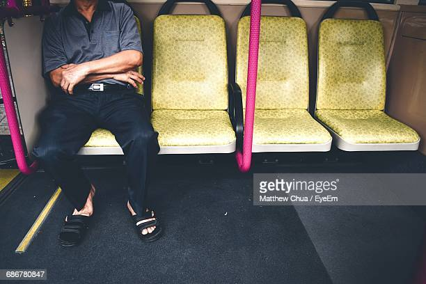 Low Section Of Man Sitting At Subway Station