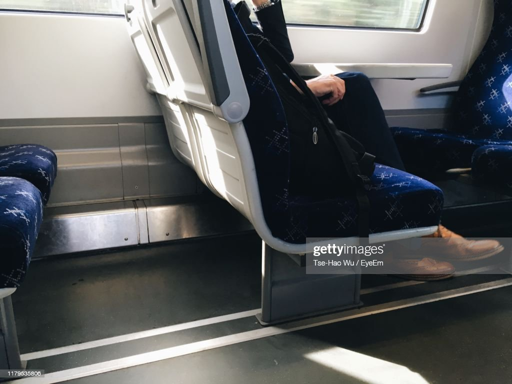 Low Section Of Man Sitting In Train : ストックフォト