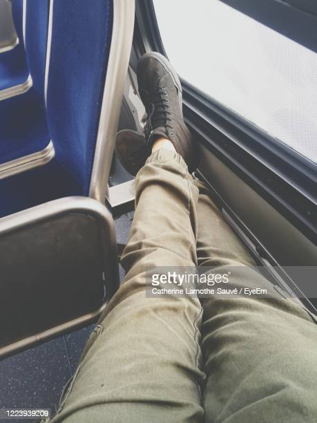 low section of man sitting on seat in a bus - low section stock pictures, royalty-free photos & images