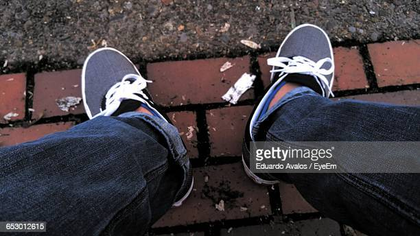 Low Section Of Man Sitting On Street