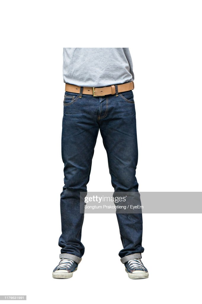 Low Section Of Man Standing Against White Background : Stock Photo