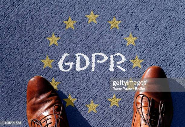 low section of man standing by gdpr text - gdpr stock pictures, royalty-free photos & images