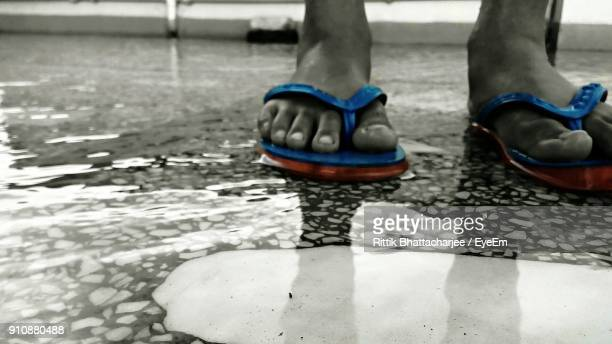low section of man standing in water - isolated color stock pictures, royalty-free photos & images