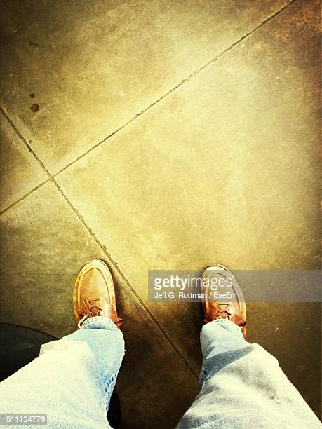 low section of man standing on floor - san angelo texas stock pictures, royalty-free photos & images