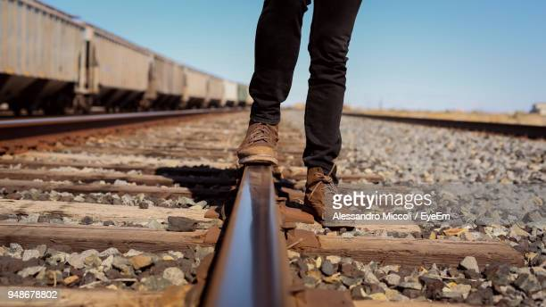 low section of man standing on railroad track - alessandro miccoli fotografías e imágenes de stock