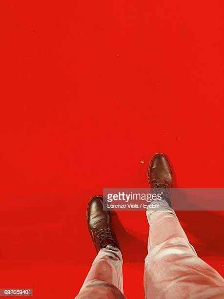 low section of man standing on red carpet - red carpet event stock pictures, royalty-free photos & images