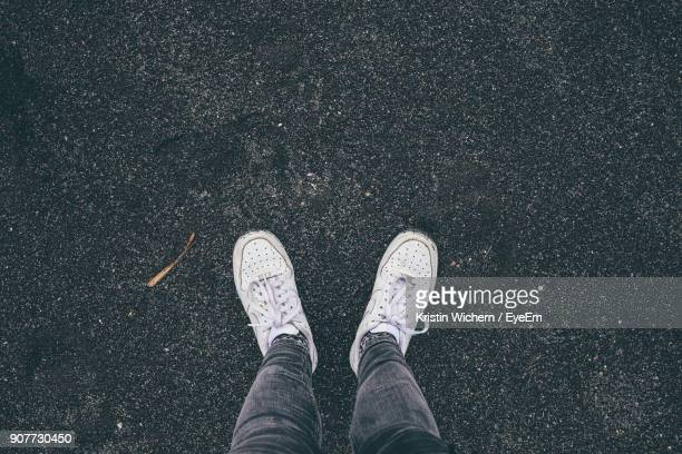 low section of man standing on road - low section stock pictures, royalty-free photos & images