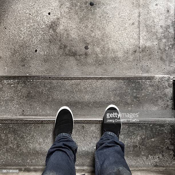 Low Section Of Man Standing On Steps