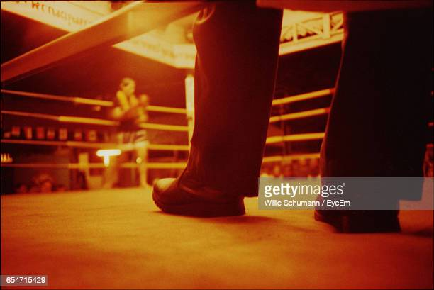 low section of man standing on wrestling ring - fighting ring stock pictures, royalty-free photos & images