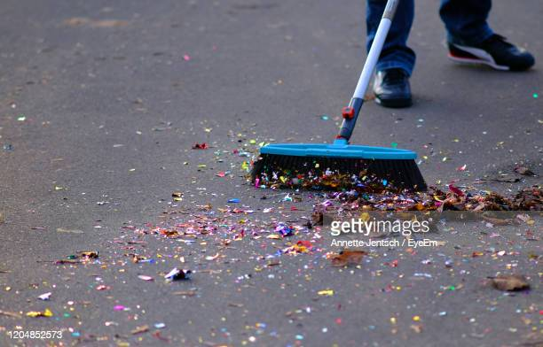low section of man sweeping street - sweeping stock pictures, royalty-free photos & images