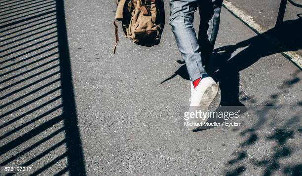 low section of man walking on street - low section stock pictures, royalty-free photos & images