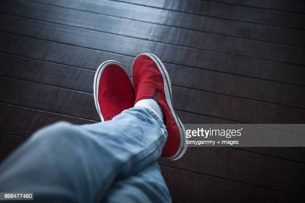 low section of man wearing red shoes - red pants stock pictures, royalty-free photos & images