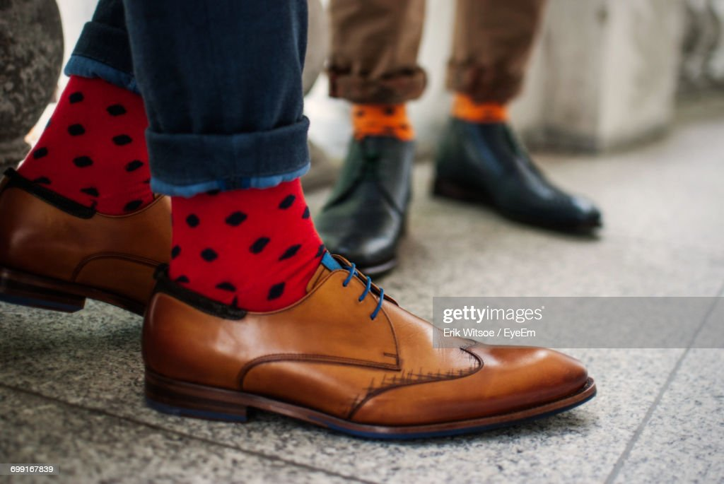 Low Section Of Man Wearing Shoes : ストックフォト