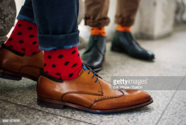low section of man wearing shoes - calzature di pelle foto e immagini stock