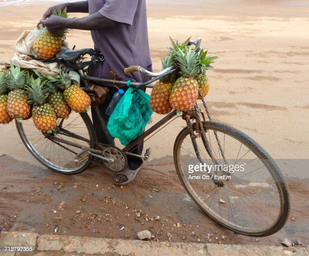 low section of man with bicycle on street - uganda stock pictures, royalty-free photos & images