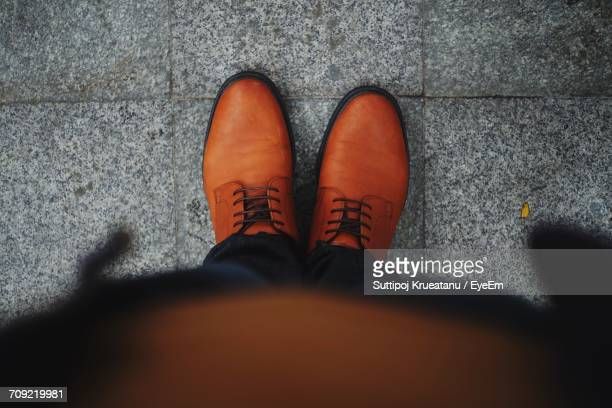 Low Section Of Man With Orange Shoes