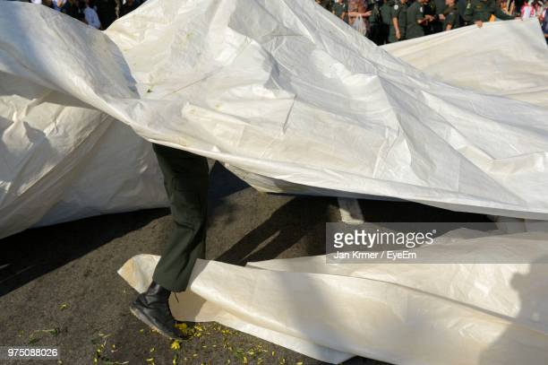 low section of man with tarpaulin - tarpaulin stock pictures, royalty-free photos & images