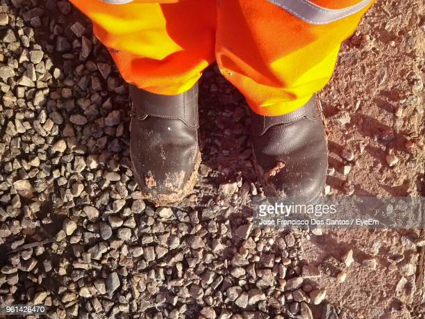 Low Section Of Manual Worker Standing On Ground