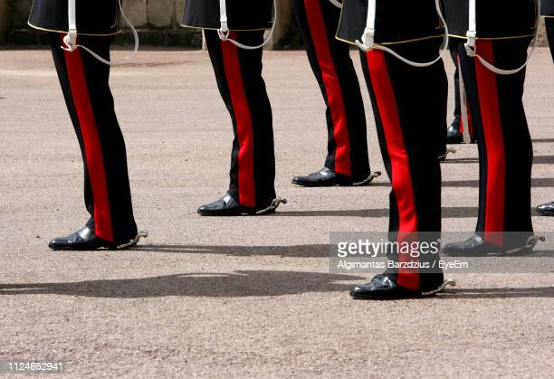 low section of marching band standing on footpath - military uniform stock pictures, royalty-free photos & images