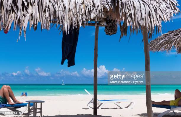 Awesome Worlds Best Man Lounging On Beach Chair Stock Pictures Ocoug Best Dining Table And Chair Ideas Images Ocougorg