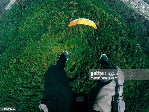 Low Section Of Men Paragliding