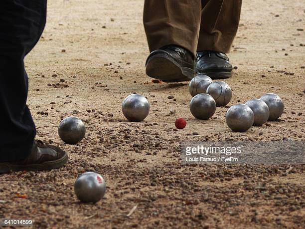 low section of men playing petanque - ブール ストックフォトと画像