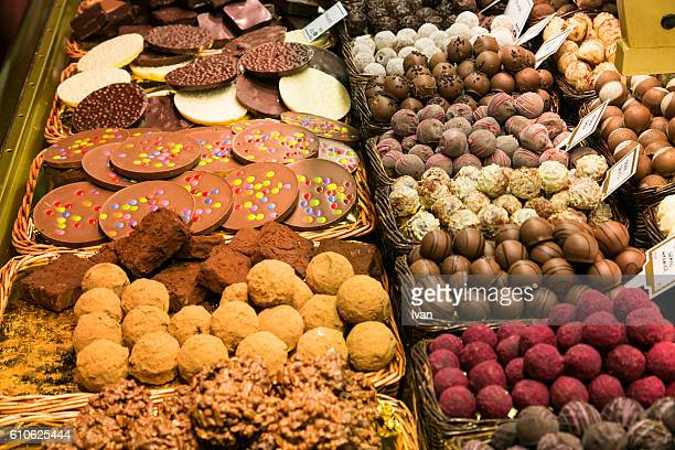 Low Section Of Men Purchasing Chocolate In Confectionery Shop
