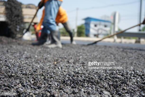 low section of men working on street - low section stock pictures, royalty-free photos & images