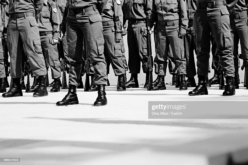 Low Section Of Military Soldiers Marching On Street : Stock Photo