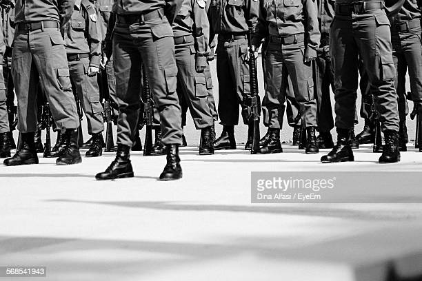 Low Section Of Military Soldiers Marching On Street