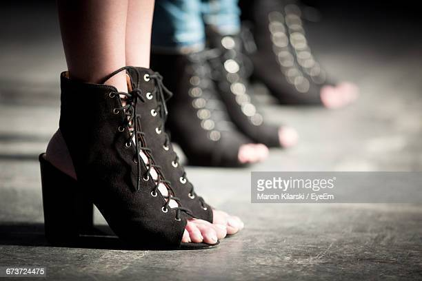low section of models wearing shoes on stage during fashion show - catwalk stage stock pictures, royalty-free photos & images