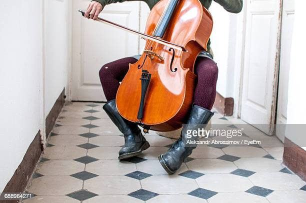 Low Section Of Musician Playing Double Bass In Corridor