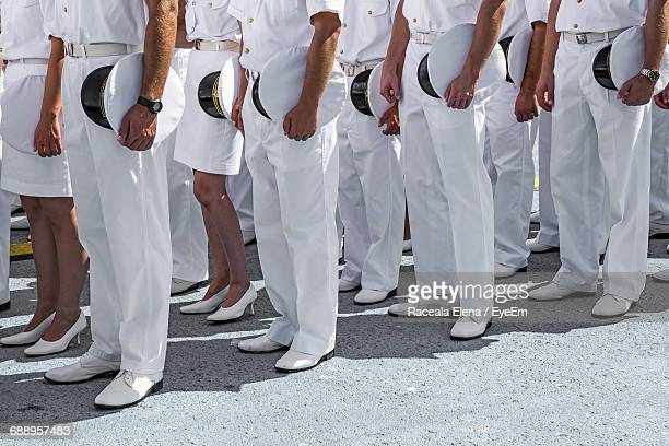 low section of naval officers standing on ground during event - navy stock pictures, royalty-free photos & images