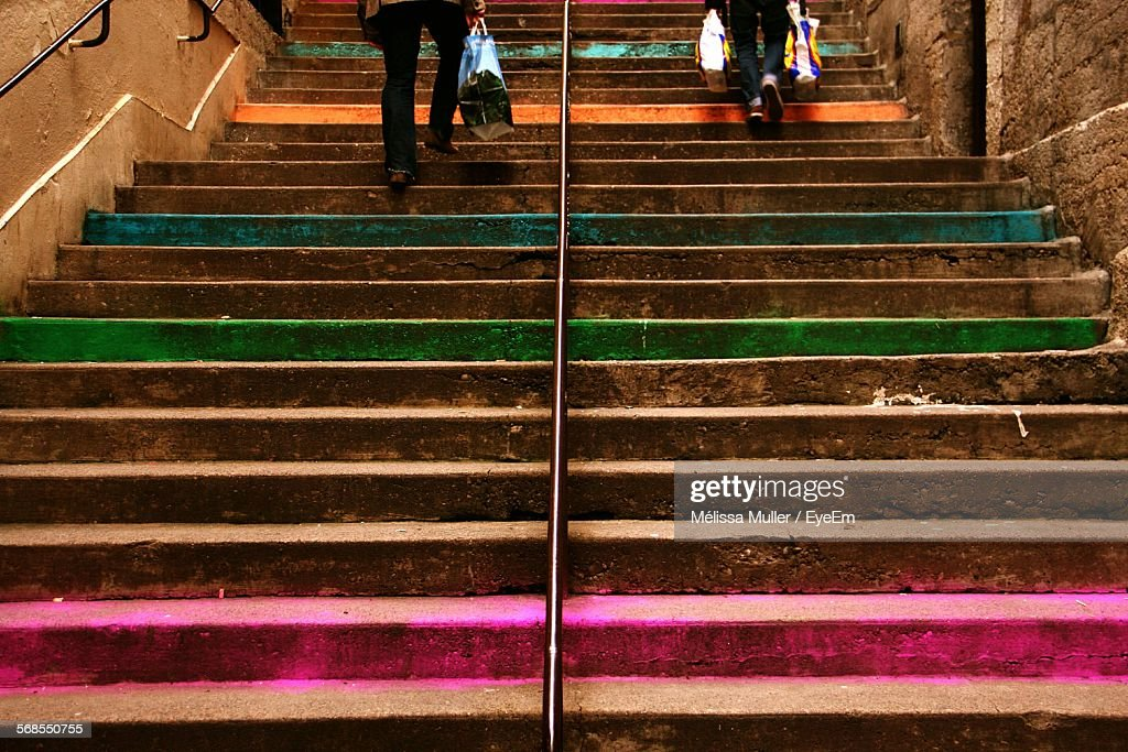 Low Section Of People Climbing Steps : Stock Photo