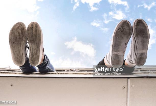 Low Section Of People Dangling Feet