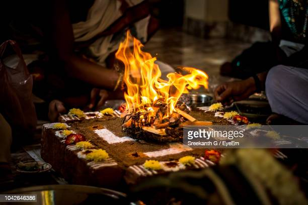 low section of people doing religious event - ceremony stock pictures, royalty-free photos & images