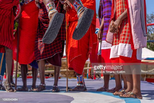 low section of people in traditional clothing standing - mombasa stock photos and pictures