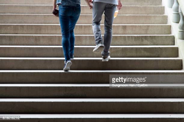 Low Section Of People Moving Up On Steps